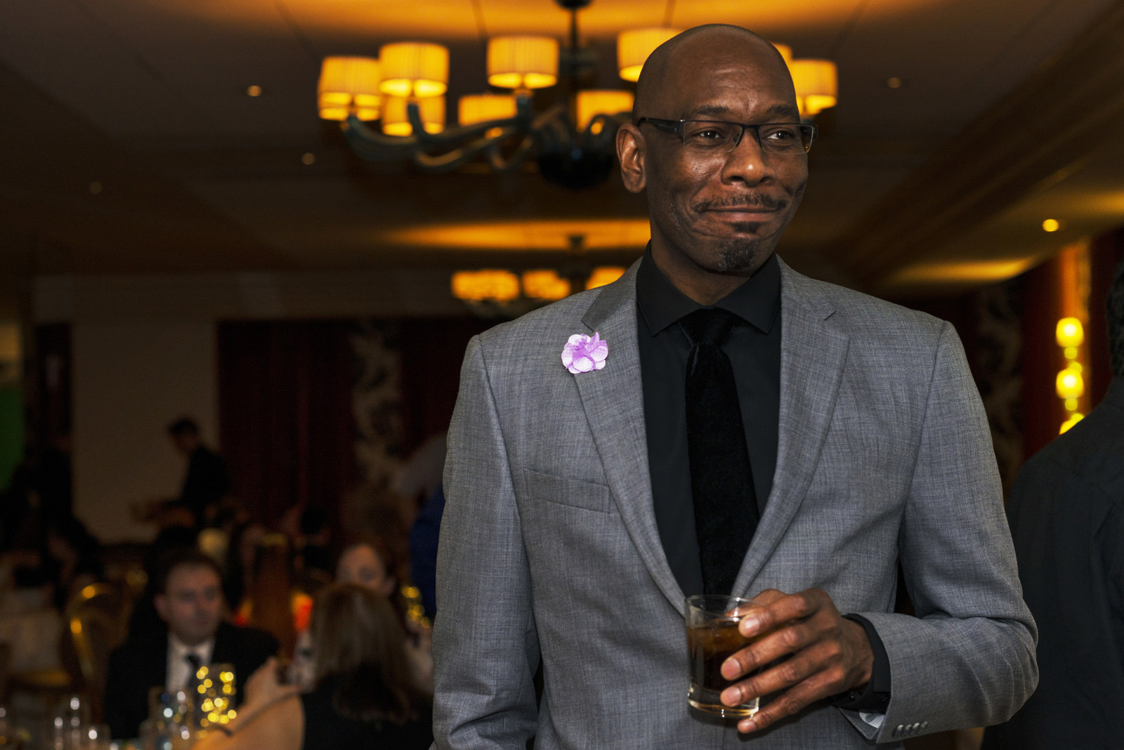 Man in suit holding drink