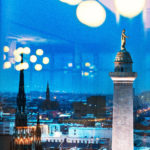 Night view out window of Washington Monument in Baltimore Mt. Vernon